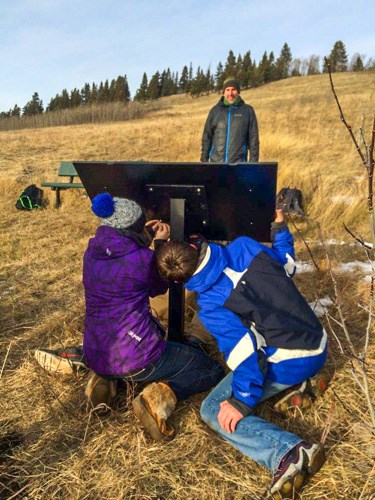 Students installing interpretive sign at Beauvais Lake Provincial Park